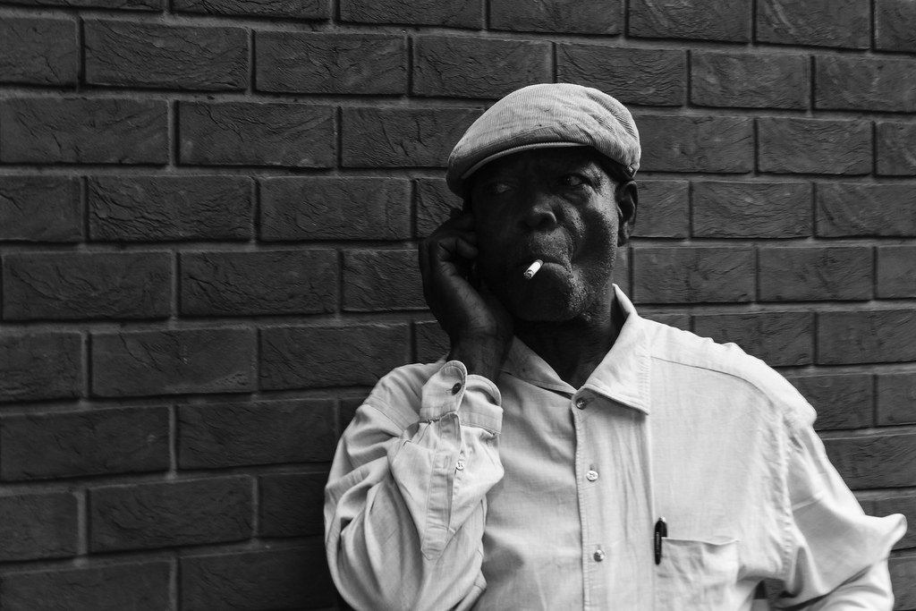 telephone skills training courses man on mobile phone smoking.