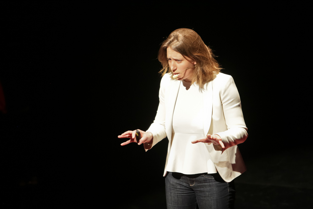 how to do successful presentations woman with mic on speaking.