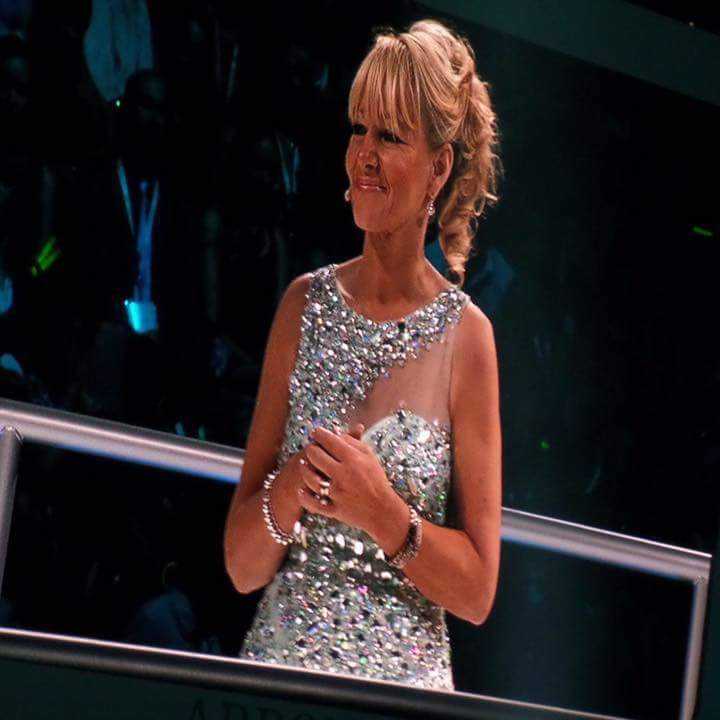 speaking to an audience training scotland arbonne woman in silver dress