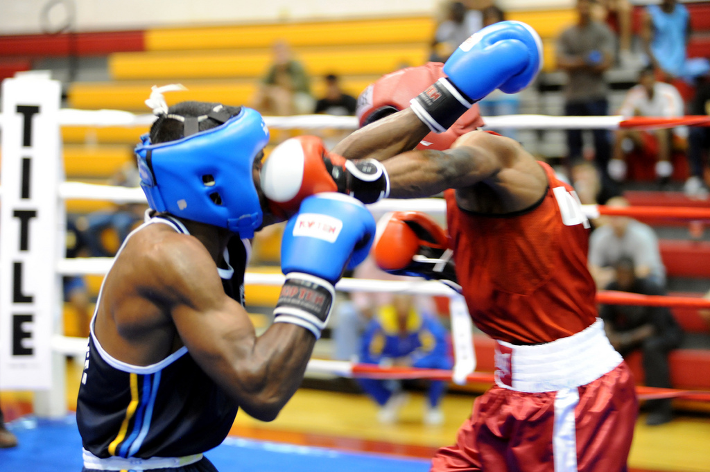 U.S. Marine Corps Cpl. Jamel Herring scores with a left jab to the face of ME Rgs Kumarasinghe of Sri Lanka en route to a 3-1 quarterfinal victory in the light welterweight division of the 2010 CISM World Military Boxing Championships Oct. 13 at Marine Corps Base Camp Lejeune, N.C. U.S. Army photo by Tim Hipps, FMWRC Public Affairs