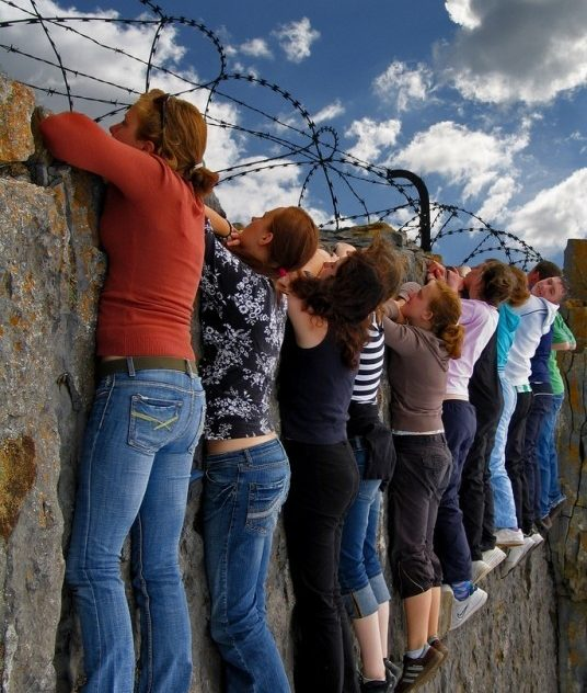 communication skills training scotland women on barbed wire wall.