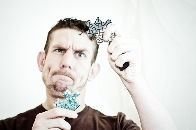 assertiveness training courses scotland man struggling with jigsaw pieces.