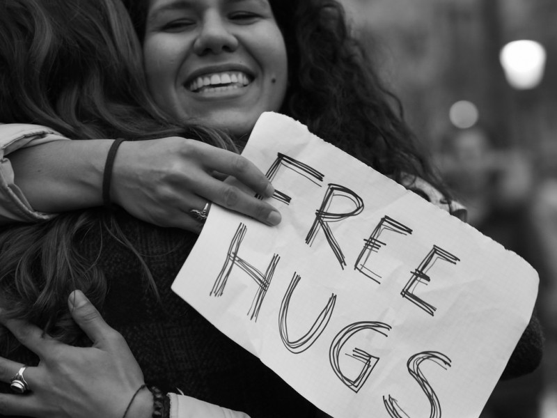 presentation scotland woman with free hugs sign.