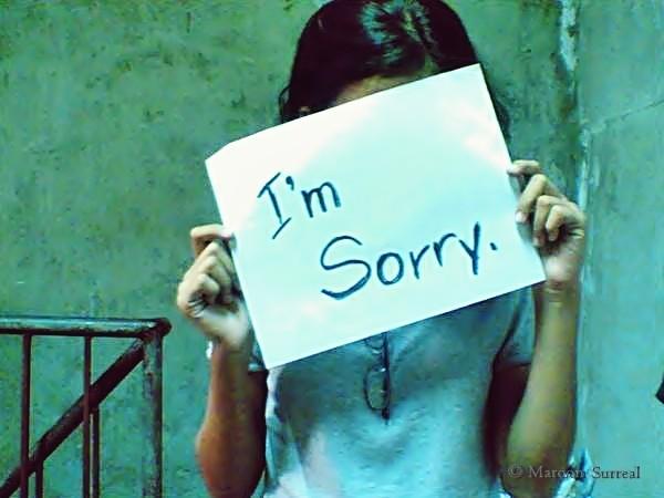 crisis communication glasgow I'm sorry sign girl.
