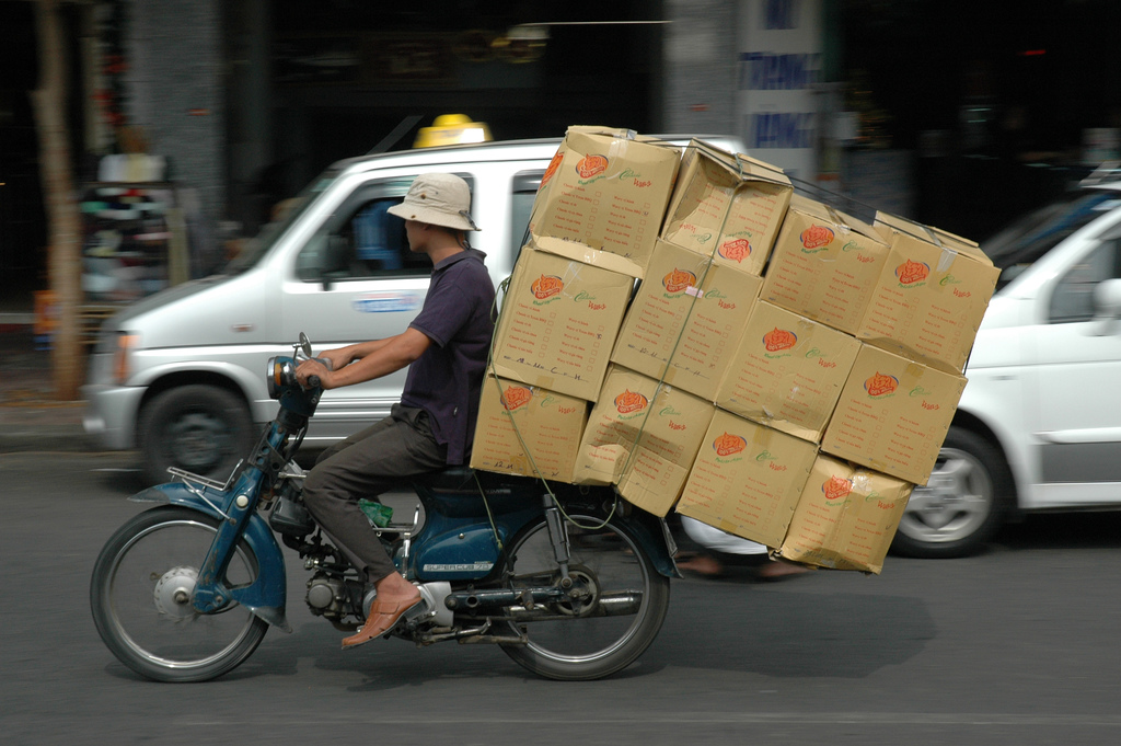 best public speakers glasgow training man on moped with boxes.