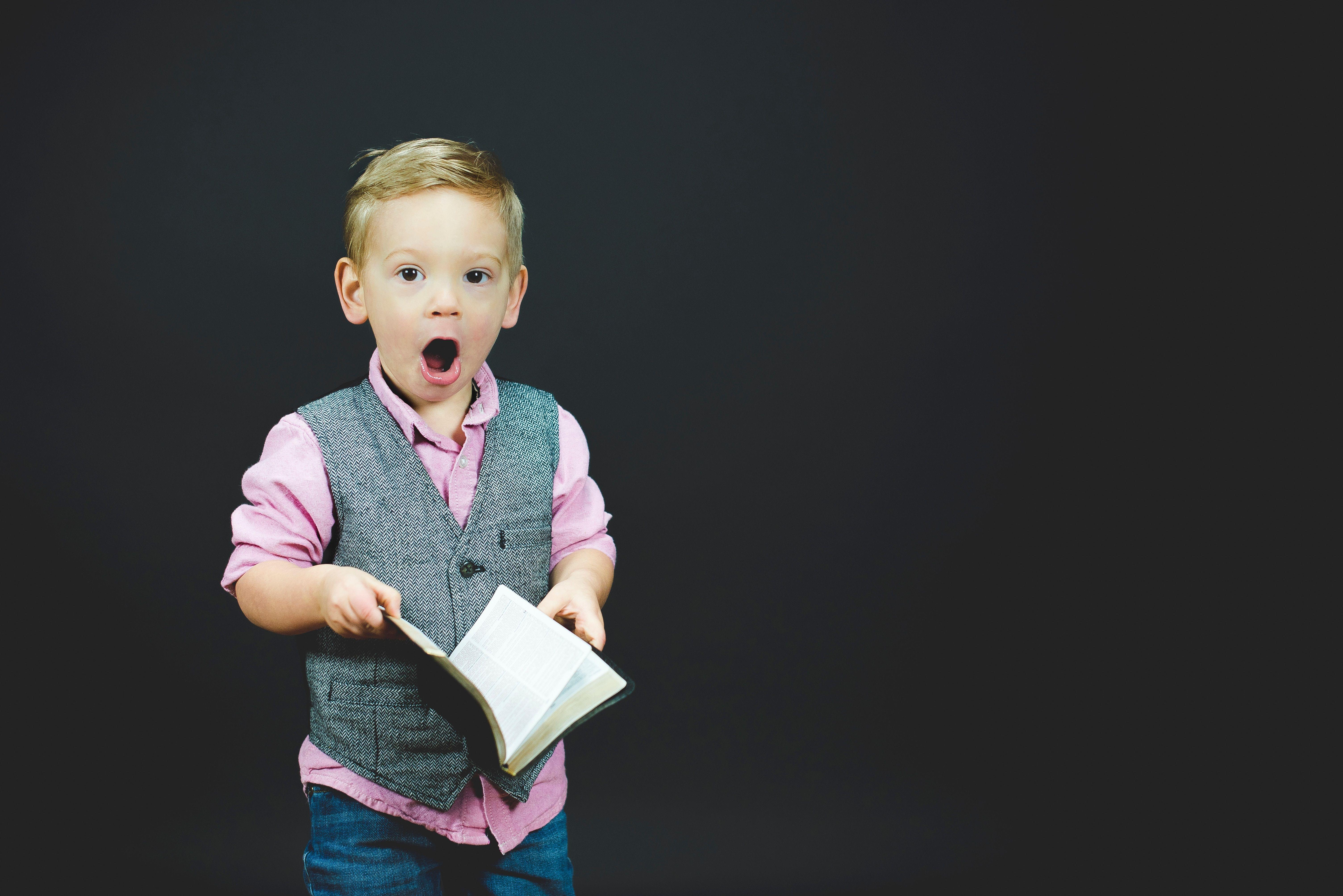 public speaking glasgow boy with book.