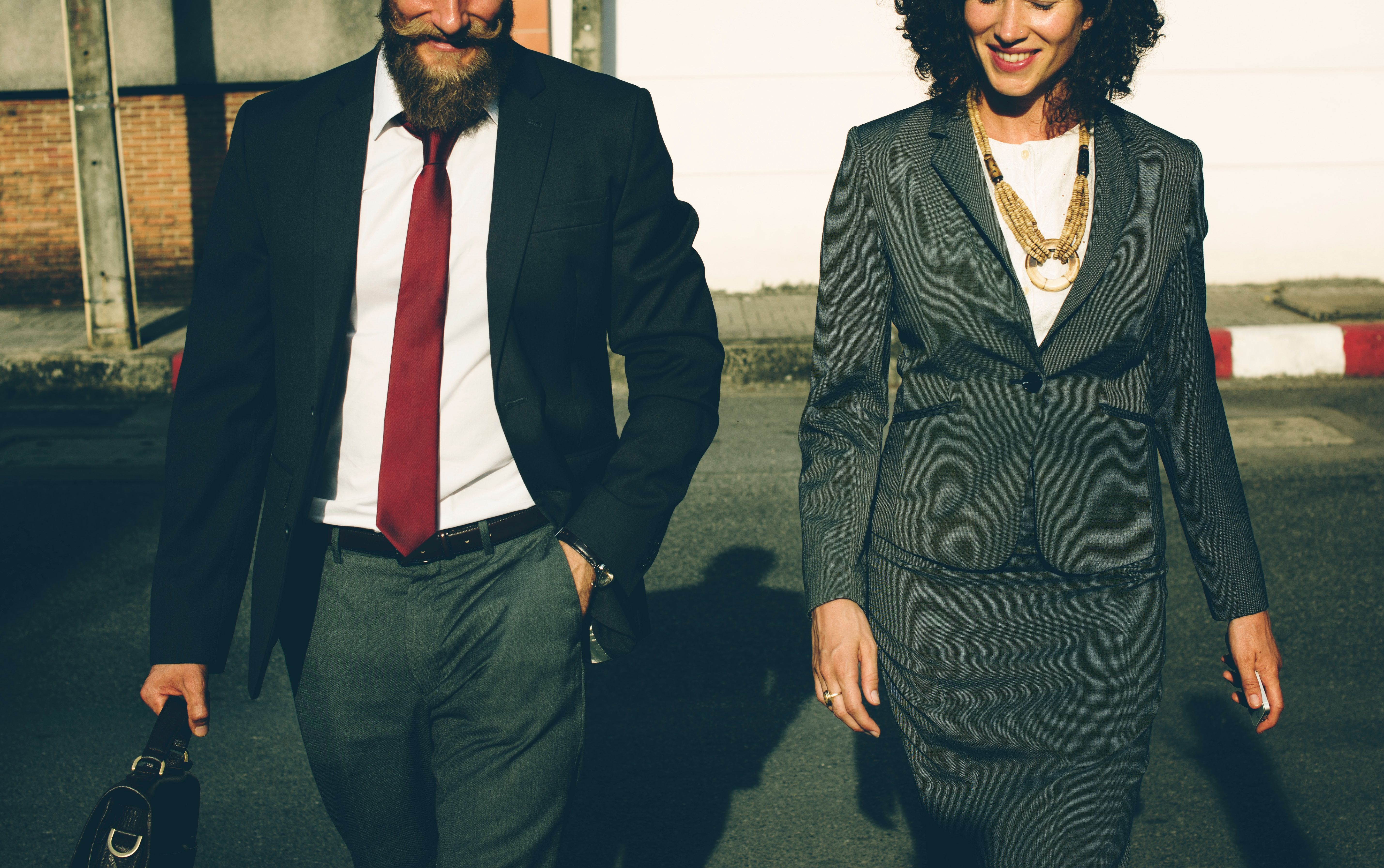 Interview Preparation Tips man and woman walking.