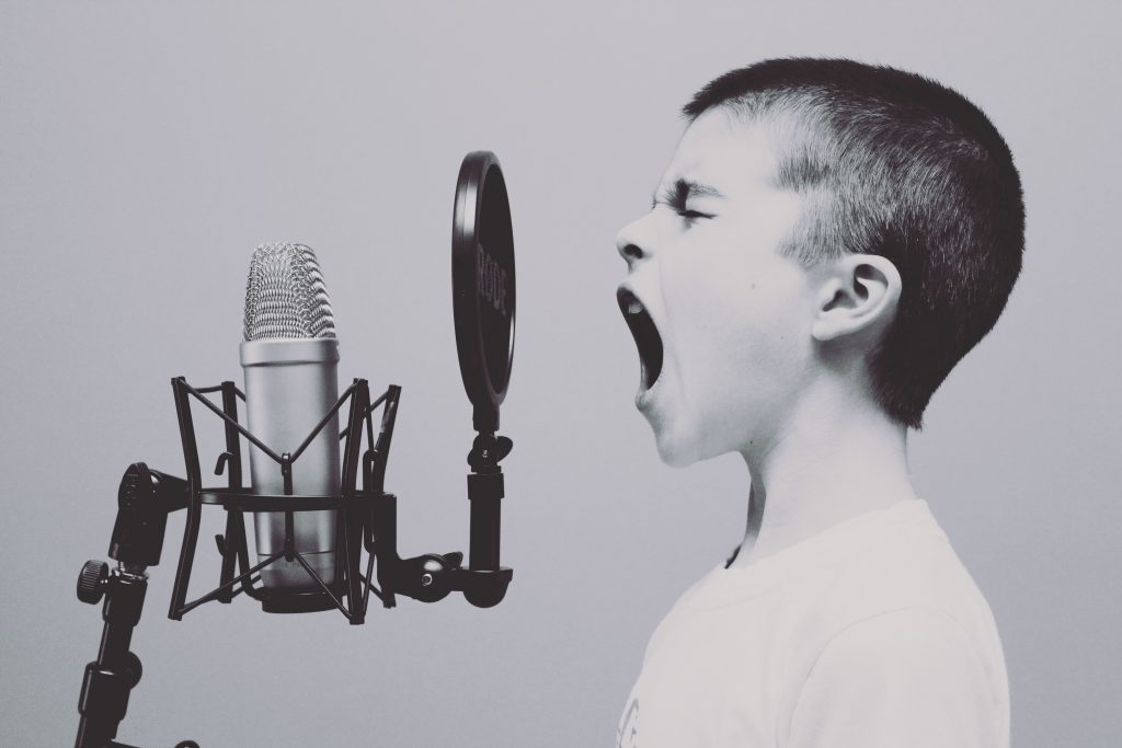 communication skills training blog - predicting success with conditions - kid shouting at mic.