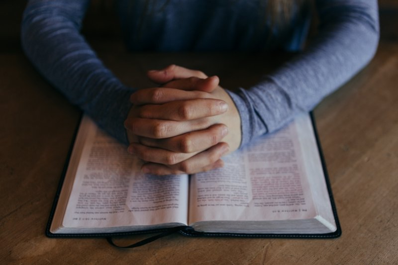 how to win over your audience, prayers, bible hands